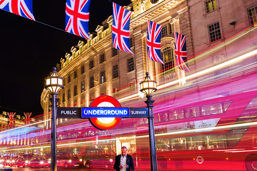 London UK - June 18 2016: Piccadilly Circus in London at night. Its status as a major traffic junction has made Piccadilly Circus a busy meeting place and tourist attraction