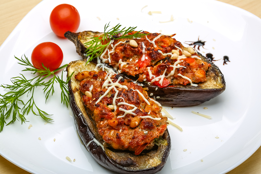 Eggplant stuffed minced meat with tomato cheese and herbs